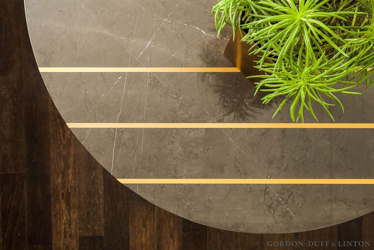 Arial shot of our bespoke dining table in grey marquina marble with brass inlay detailing.   #GD&LBespokeFurniture