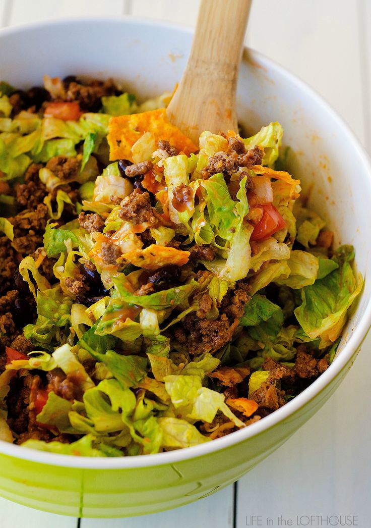 My family and I love this salad. It is packed with all kinds of deliciousness. Seasoned ground beef, black beans, cheese, lettuce and don't forget the Nacho cheese Doritos.  They make the salad!     This Doritos Taco Salad comes together in just about 20 minutes tops! Salads like this are my go-to for …