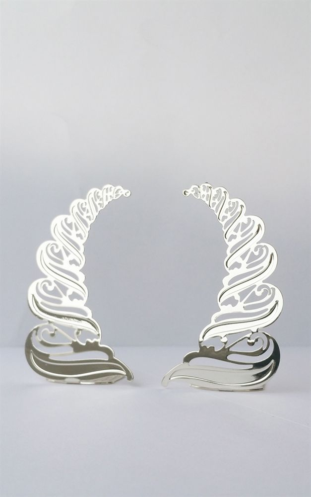 The Original Atelier Large Silver Horns Stunning, intricate, devil horns from The Original Atelier. These beautiful hand made large metal horns include vine like twists and flourishes within their design....