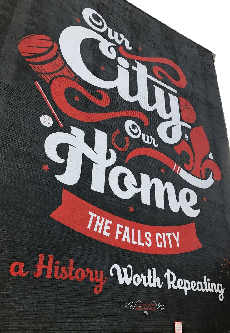What do a bourbon barrel, a bat, a horseshoe, a basketball, and a fleur de lis symbol all have in common? They're symbols of Louisville, the Falls City. Remember your visit with a photo in front of this mural on Market Street.