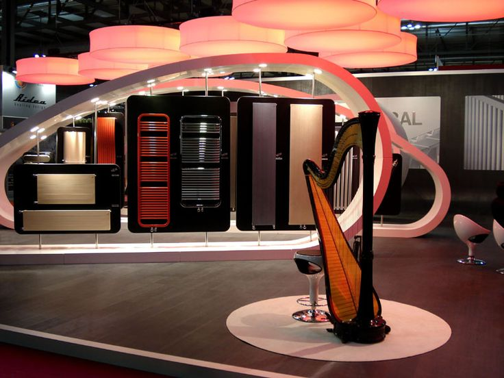 Harps by Giancarlo Zema for Runtal a brand of the Zehnder Group. It is 260sqm modular exhibition stand in corian, the ispiration came from observing the harp as a sensual and magic musical instrument, so large harps in corian from 6 to 10 metres long and 3 metres high, were designed to accomodate items of the Runtal collections on rotating black panels. The composition of harps has been made simpler thanks to the use of light ashlars with sophisticated steel closures. #CorianDesign…