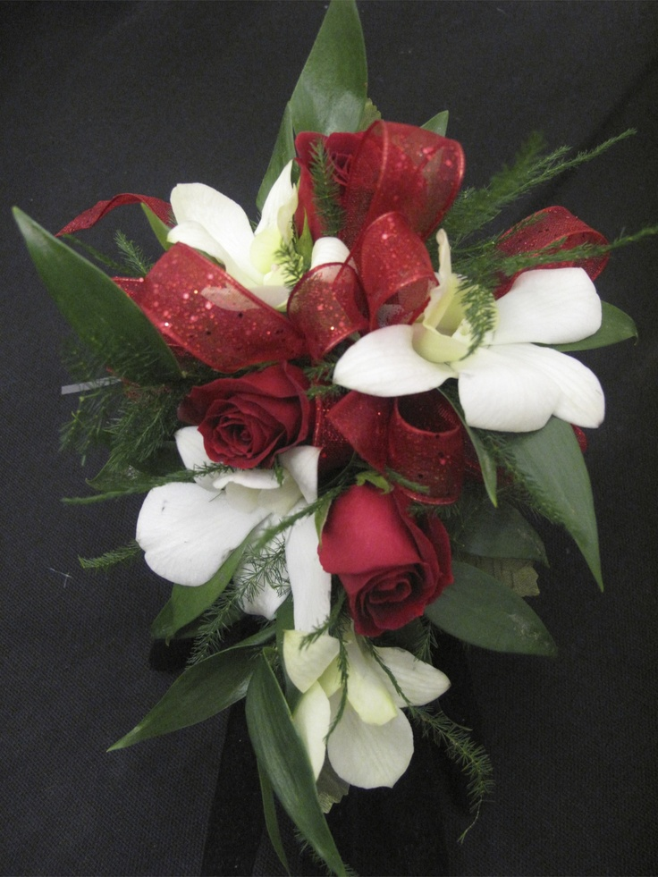 Red Spray Roses and white dendrobium orchid corsage for Prom, Homecoming, or any occasion by Tillie's Flower Shop www.tilliesflowers.com