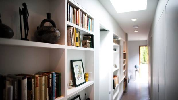 Hallway with bookcases, designed by Vancouver architect, Peter Pratt