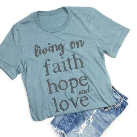 """Current Processing time for this item is 5-6 business days before it ships out. This is a super-soft unisex t-shirt with our """"Living On Faith Hope and Love """" design. Fit: Unisex and runs true to size."""