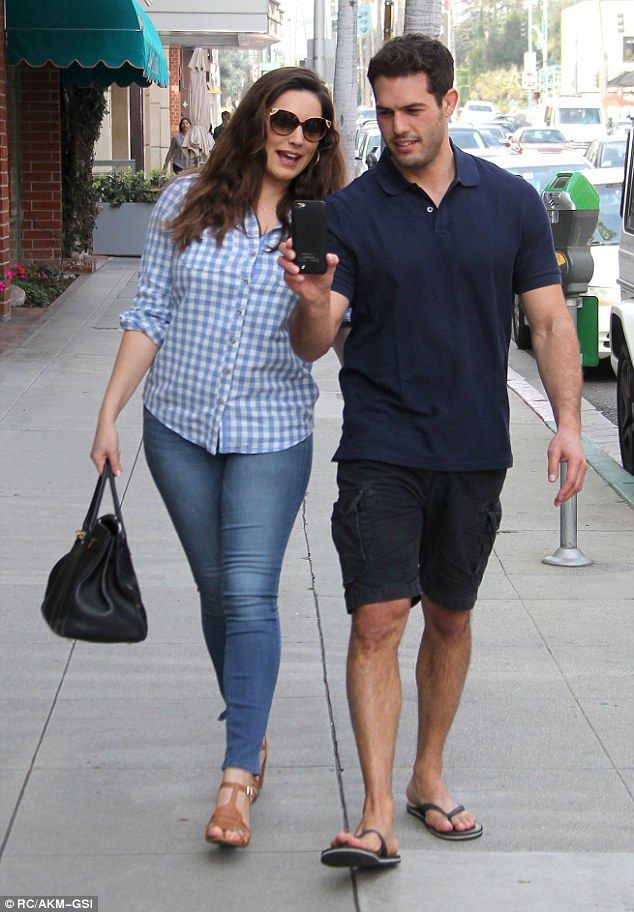 Taking a stroll: Kelly Brook headed out with boyfriend Jeremy Parisiin Beverly Hills on Thursday afternoon, for a leisurely stroll