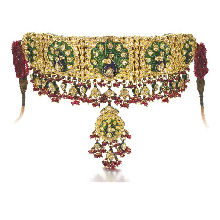 RUBY, ENAMEL AND DIAMOND DEMI-PARURE, CIRCA 1900, WITH LATER MODIFICATIONS Comprising: a bazuband composed of a graduated series of plaques depicting peacock motifs, applied with polychrome enamel and lasqué-cut diamonds, suspending similarly set floral motifs and ruby beads, can also be worn as a choker; and a pair of earrings en suite, post, butterfly and hinged back fittings, part illustrated.