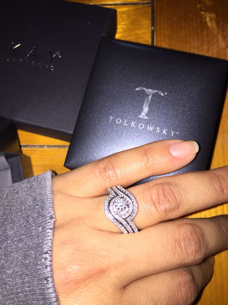 TOLKOWSKI swirl engagement ring with two accent rings. Love my ring!