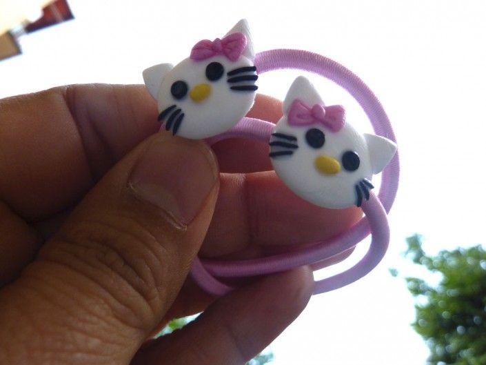 Pink hair laces decorated with Hello Kitty in polymer clay handmade - Lacci per capelli rosa decorati con Hello Kitty in fimo fatto a mano