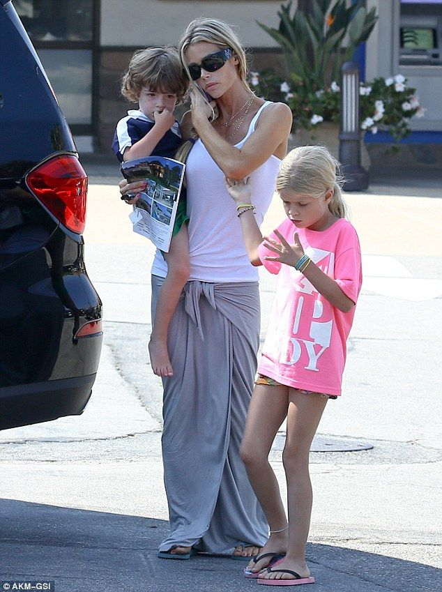 Denise Richards clutches a house listing as she continues to care for FIVE kids