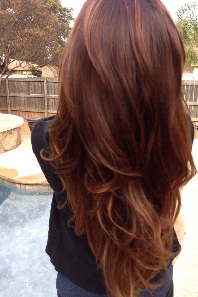 Don't these killer reddish chestnut locks with caramel highlights pop?  Long vibrant auburn hair with a hint of curl like this looks Pinterest perfect.  Depth.  Dimension. Impact color. If you need help achieving a look like this for your mane TerrificTresses.com can get you a totally put together look.