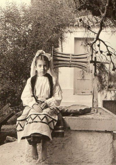 Greek girl in traditional clothing from Corfu.
