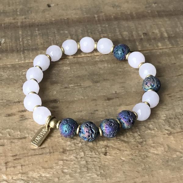 Essential Oil Diffuser bracelet made with rose quartz and titanium coated lava. #diffuserbracelet