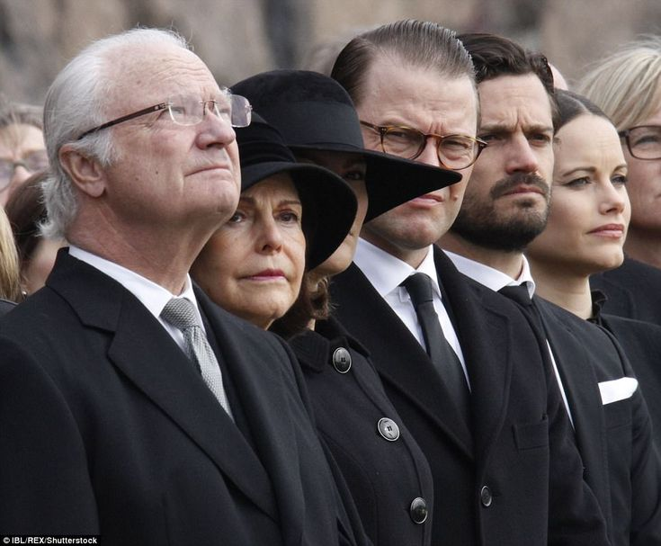 King Carl XVI Gustaf also attended the silence at city hall, alongside (left to right) wifeQueen Silvia, Crown Princess Victoria, Prince Daniel, Prince Carl Philip and Princess Sofia