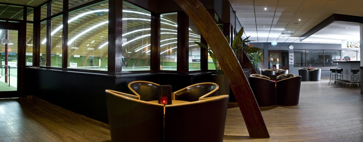 Sports bar overlooking the indoor tennis courts at Inntel Hotels Resort Zutphen