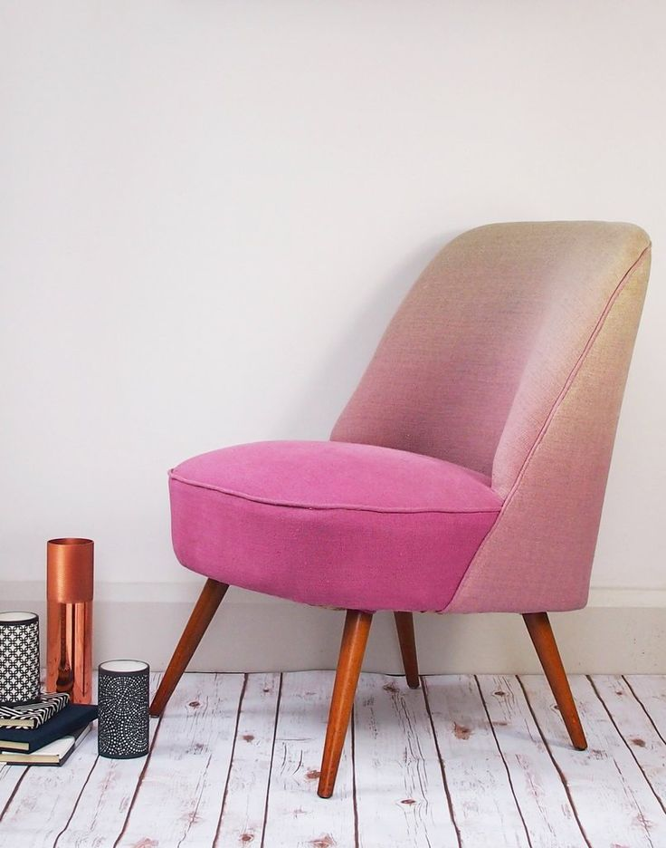 A statement piece for bedroom or living room, this stylish pink midcentury chair just pops!