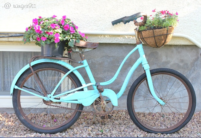 old bike planter from I Love That Junk.  I have an old bike that I am doing this except that I am planting it in the garden to halfway up the wheels and replacing the seat with a plant pot and letting vines grow on it....