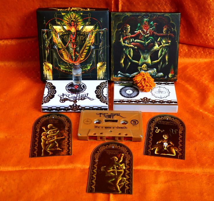 Cult Of Fire - Live,Sex and Death MC Box.   MC edition made in collaboration with Triangulum Ignis. Limited to 300 copies, each of its boxes are handcrafted from scratch, printed in a traditional offset machine, and adorned with gifts from the Ganga river. Each offertory will consist of a Marigold flower recovered and gathered from the garlands worn by the dead, and water from the Sacred River in the cities of Mayapur and Varanasi. 18.00€ Order here : beyondeyes@seznam.cz