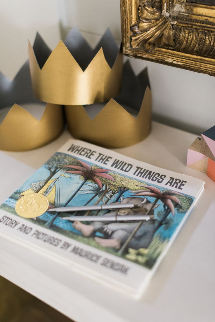 "Stumped on a baby shower theme? Take inspiration for your favorite children's book and let it dictate all your hosting decisions. Here, ""Where The Wild Things Are,"" sets the scene for whimsical details, like paper crowns for each of the guests to wear."