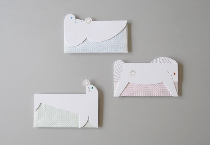 「RING」 Charming animal shapes form the envelopes for simple greeting cards. Glassine envelopes featuring animal flaps cut out of sturdy paper are semi-transparent, revealing the pattern of the enclosed letter card. Each whimsical animal bears a golden embossed ring, symbolizing happiness and good tidings.