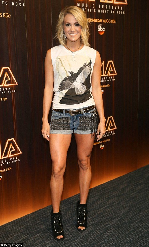 She has great jeans! Carrie Underwood sizzled in jean shorts paired with a tank top that had a bird design at a CMA Festival press conference in Nashville on Friday