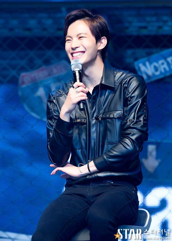 Chained up #HONGBIN<--his smile is the most gorgeous thing on the planet.
