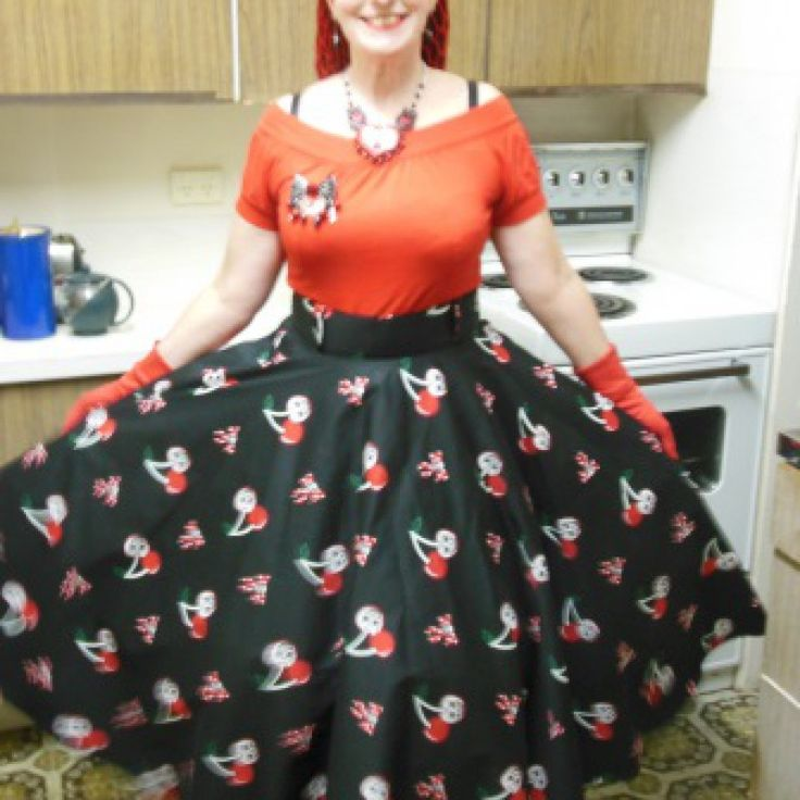 Rockabilly Cherry, Skulls and Bows Circle Skirt  This is a circle skirt with a difference. It has extra stiff interfacing in the waistband - which accentuates your waist line beautifully. It almost looks as though you have a small waist cincher. It is comfortable to wear. The waist band also has wide belt loops. The skirt has a side zipper with a metal(vintage style) zipper and a large polka dot button. In the photos I have a petticoat on - this isn't included.