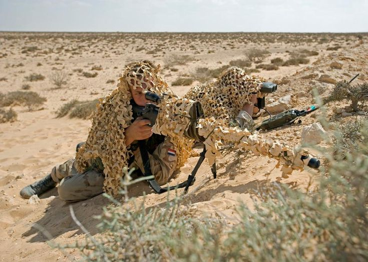 A Dutch ISAF sniper team displaying their Accuracy International AWSM .338 Lapua Magnum rifle and Leica/Vectronix VECTOR IV laser rangefinder binoculars. [959  682]