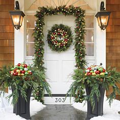 christmas ornaments in urns, garland, greenery, wreath