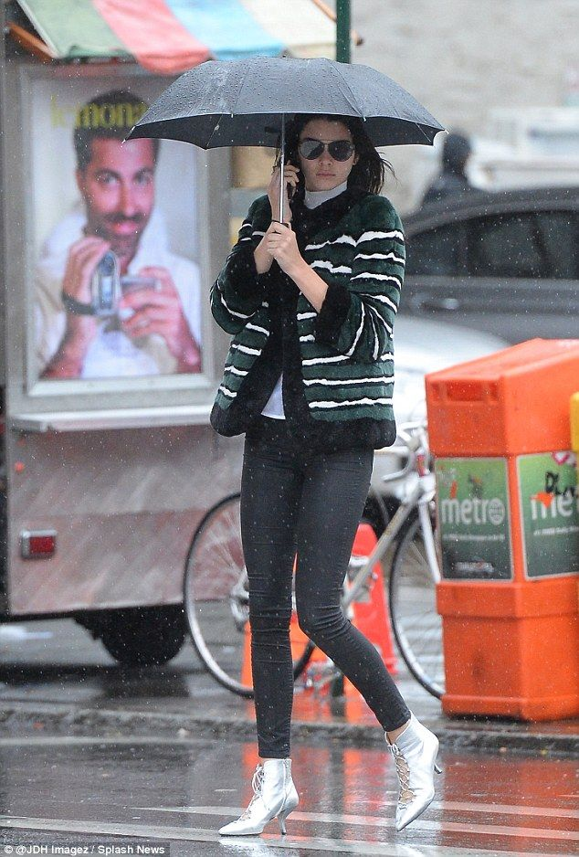 Bright spot: Kendall Jenner wore silver lace-up boots with kitten heels while out in Soho on Wednesday