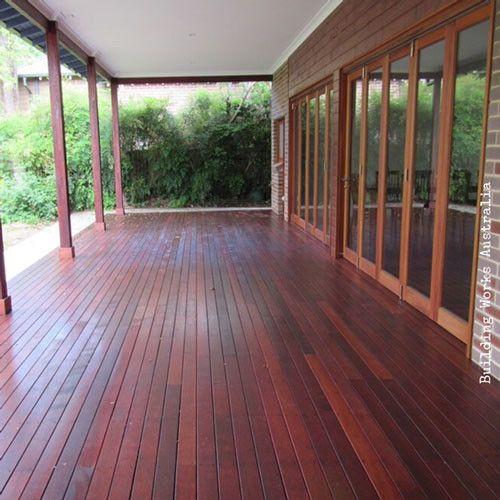 Oiled Merbau deck with laminated oiled Merbau verandah posts #decks #verandahs #verandahposts #bi-folddoors www.buildingworksaust.com.au @buildingworksau