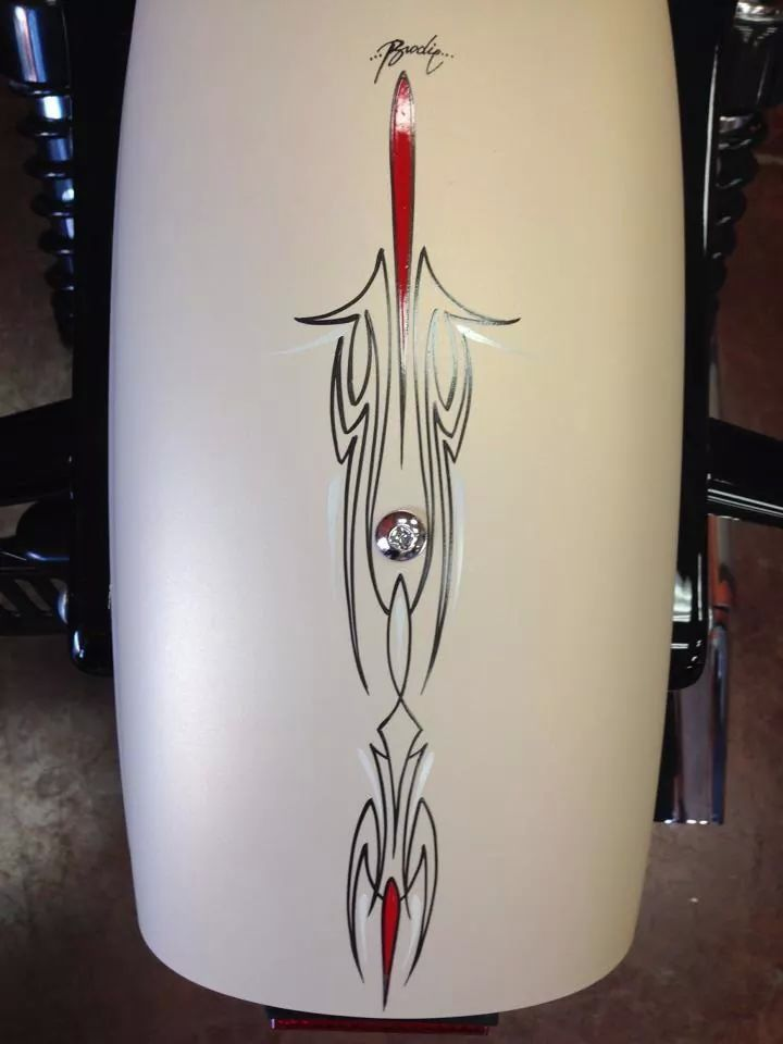 Black and red pin stripes on white motorcycle fenders by Mark Brodie