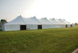 Pole Tents come in many large sizes and can be setup on most surfaces AND they include walls if it's chilly!