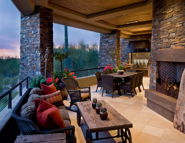 Desert southwest soft contemporary architecture beautiful short wall preserves views blends beautifully with stone columns and fireplace