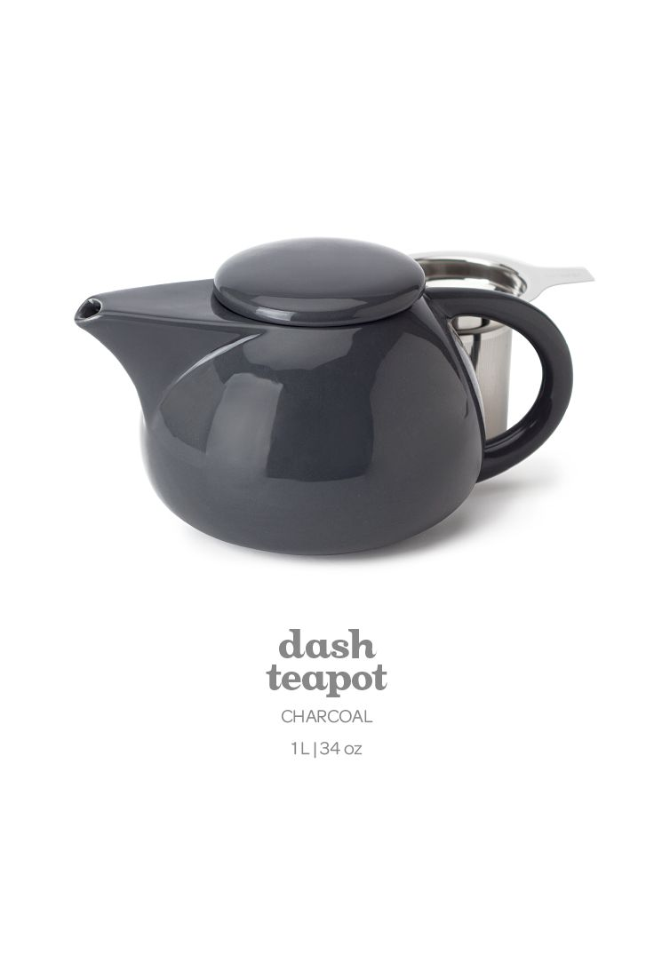 A sleek, modern tea pot with a stainless steel infuser.