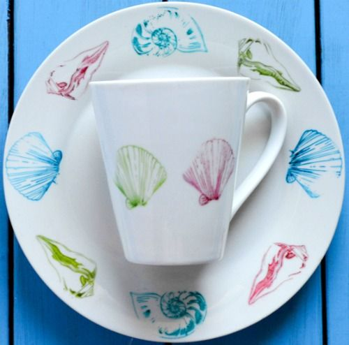Learn how to paint dishes (plates and mugs) with alcohol inks and sharpie pens dishwasher safe! Featured here: http://www.completely-coastal.com/2016/03/paint-plates-dishes-mugs-with-sharpie-pen-alcohol-inks.html