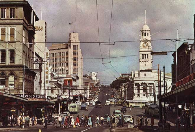 These pedestrians are crossing at the intersection of Auckland's Queen and Wellesley streets, about 1960. By the 1950s city dwellers crossed busy streets at their peril, and most used pedestrian crossings for their own safety.