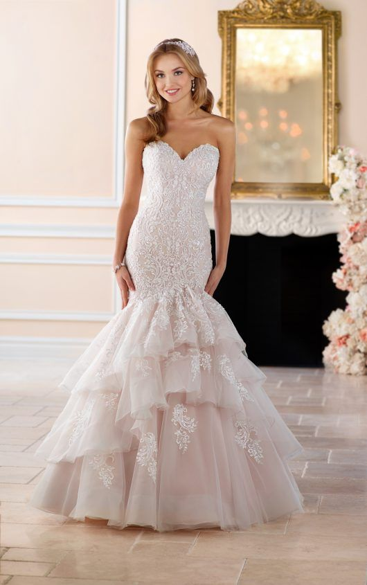 6405 Dramatic Lace Fit and Flare Wedding Dress by Stella York. Find this dress at Janene's Bridal Boutique located in Alameda, Ca. Contact us at (510)217-8076 or email us info@janenesbridal.com for more information.