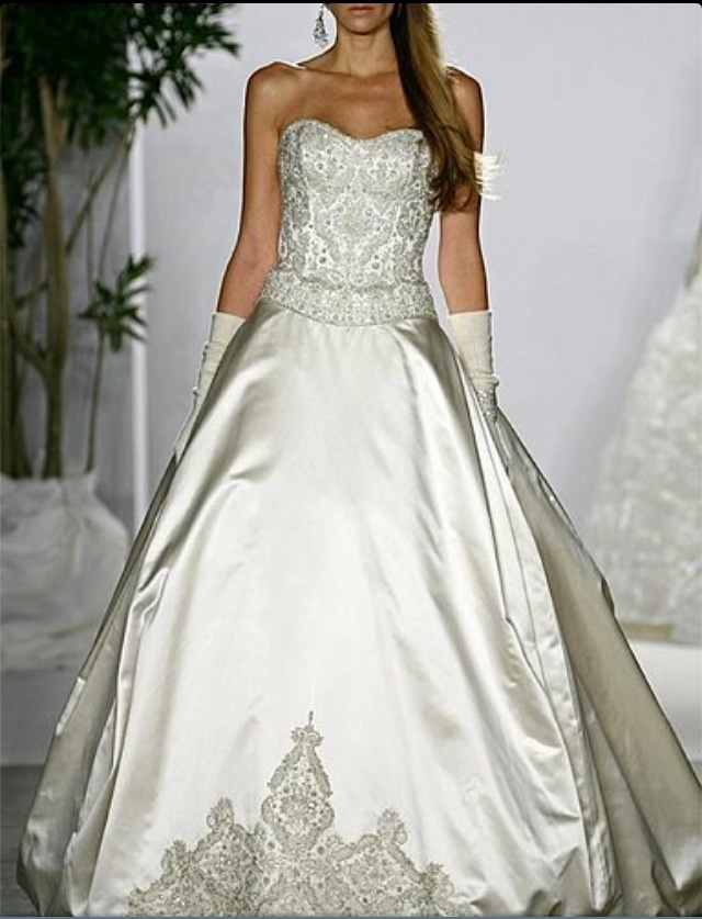 Platinum Priscilla of Boston by Kenneth Pool- this was my wedding dress before the designer and I made some changes and additions :)