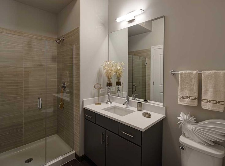 Model bathroom featuring porcelain tile bath flooring for Model bathrooms pictures