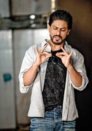 SRK doing something cute with his hands