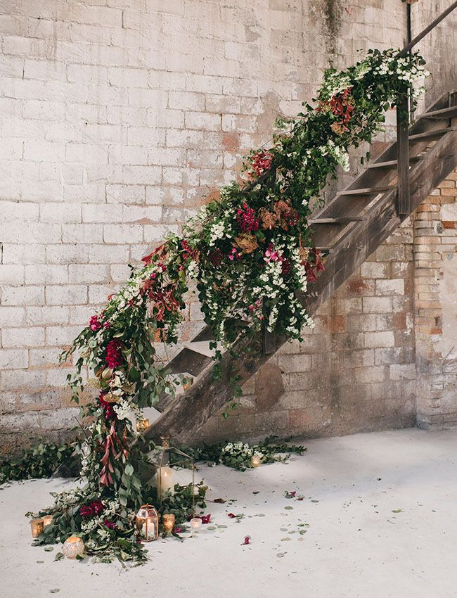 floral staircase - can be just a few colorful flowers and mostly greenery/vines to make it affordable and doesn't have to go all the way up..just enough to make an impact