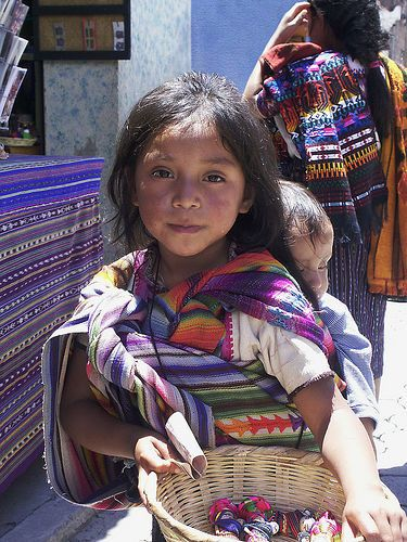 """""""I'm a simple person who hides a thousand feelings behind the happiest smile.""""   <3 lis   Maya girl selling worry dolls at the Chichicastenango market, Guatemala by wabs, flickr #world #cultures"""