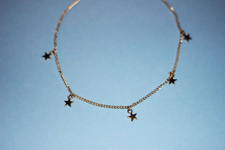 "Stargaze choker will have you looking sparkly and sweet.  Handmade and designed by OVERSCHOOLED  gold plated necklace      * to keep your jewelry lasting long don't wear it to bed, keep it out       of water, and tuck it away when off     * made to order     * 14.5"" length including cl"