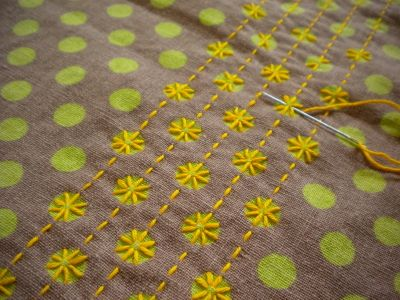 sashiko in modern style...it could be a polka dot version of broderie swisse