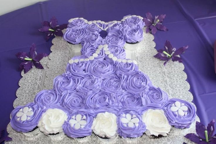 This is a cupcake cake replica of Disney's Sophia the first princess dress. It matched my daughters dress for her princess party.