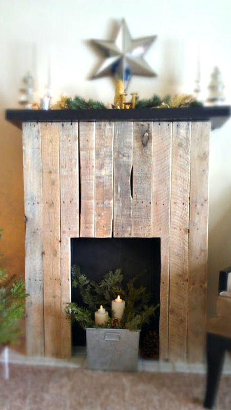 DIY Pallet Fireplace/Mantle ~ rustic, charming and wonderful faux fireplace... fun to decorate and hang stockings on it for Christmas