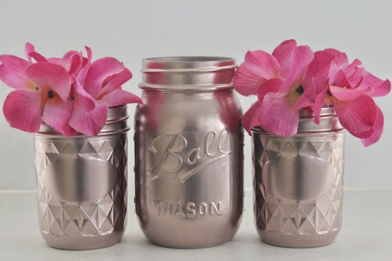 A beautiful addition to your event decor.  These jars look spectacular as centerpieces filled with fresh flowers.  They have a touch of violet in the pretty rose gold color.  This listing is for 1 pint size jar and 2 jelly jars.   Dimensions:  Pint Size Mason Jar is 16 ounces  Product in Inches (L x W x H): 3.2 X 3.2 X 5.2   Jelly Jars are 8 ounce jars  Height 4 inches  Diameter 2.5 inches   Mason Jar Disclaimer:  These may be filled with water for flowers as the inside is not painted. No…