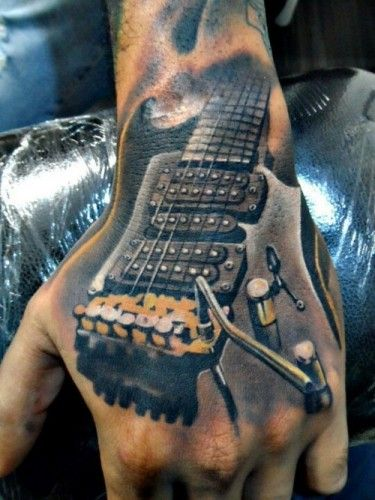 12 guitar hand tattoo by Leo Rojas