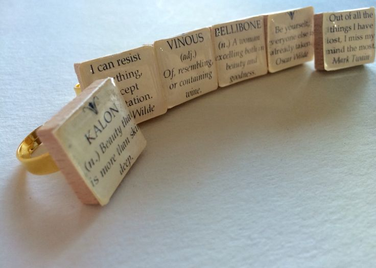 A snapshot of some scrabble tile rings that I made featuring quotes and unusual words and their definitions