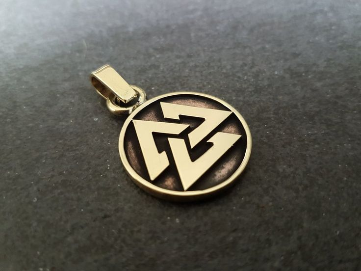 Viking norse valknut pendant made out of brass and solder.